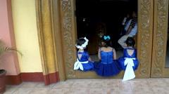 Cute flower girls in blue dress having fun at church doorstep Stock Footage