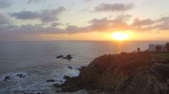Rising above Laguna Beach, California during Sunset Stock Footage