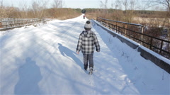 Boy goes on winter road Stock Footage