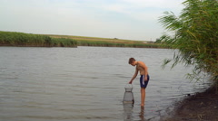 Teenager in the lake-caught fish Stock Footage