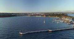 Cinematic flight around Mornington Pier and marina at sunset Stock Footage