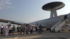 BANEASA ROMANIA-JULY 5 2016 Rotating radar and people visit Boeing E-3 Sentry Stock Footage