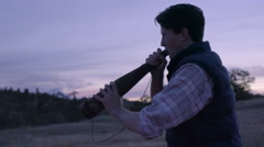 Hunter Practices Making An Elk Call With An Elk Bugle, He Laughs Stock Footage