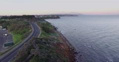 Short flight along Mornington coastline at sunrise Stock Footage