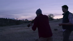 Hunter Practices Using An Elk Bugle, His Brother Shows The Proper Way To Do It Stock Footage