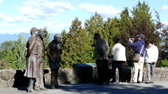 People sightseeing and taking picture at Queen Elizabeth Park Stock Footage