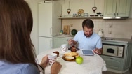 Young couple having dinner at home. Modern dating Stock Footage
