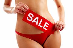 Torso of woman in red panties holding SALE tablet Stock Photos