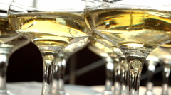 Glasses with champagne close-up on the table. Stock Footage
