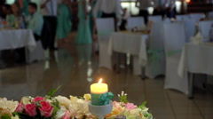 Decorative candle lights on the wedding table. Stock Footage