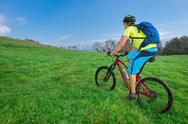 A young male riding a mountain bike outdoor Stock Photos