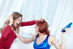 Two furious women having a quarrel Stock Photos