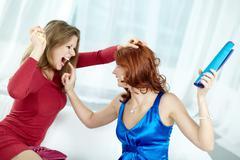 Two crazy women hitting each other vigorously Stock Photos
