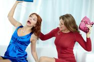 Crazy woman tearing hair of her girlfriend and beating her Stock Photos