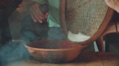 Cooking rice, close up of putting rice and water into bowl, balinese kitchen Stock Footage