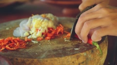 Close up of red pepper chopping on balinese kitchen Stock Footage
