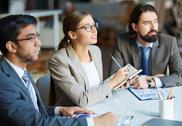 Business team at presentation Stock Photos
