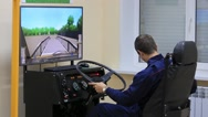 Students at the school, training on driving techniques on simulators, Stock Footage