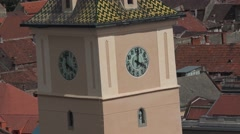 Zoom in clock of the Main Square (Piata Sfatului) of Brasov in Romania 4k UHD Stock Footage