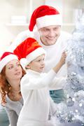 Christmas preparations with parents Stock Photos