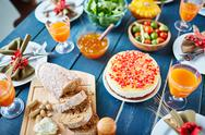 Rye bread and cake with pomegranete seeds on Thanksgiving table Stock Photos