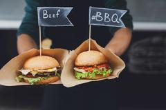 Street fast food, hamburgers with bbq grilled steak Stock Photos