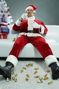 Gluttonous Santa Stock Photos