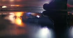 Night street rain puddle reflections abstract background blur bokeh 4K UHD Stock Footage