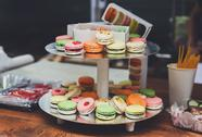 Colorful macaron cookies on bar for sale Stock Photos