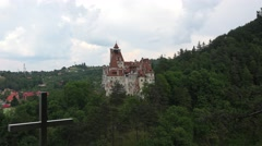 Zoom in Bran Castle Dracula Legend with a scary cross around. Stock Footage