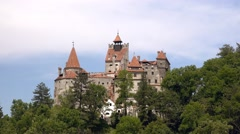 Zoom out Bran Castle Dracula Legend. Summer view in a sunny day 4k UHD Stock Footage
