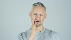 Toothache , Man Suffering from Pain In Teeth  Stock Footage
