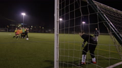 March 2016. British youth soccer team practice penalties during training Stock Footage