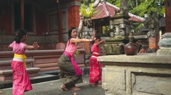 Balinese woman teaching girls how to dance in village Stock Footage