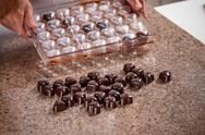 Making chocolate candies Stock Photos