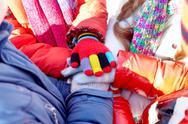 Heap of hands of children in winter gloves Stock Photos