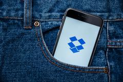 Dropbox is a free sharing pics, videos and documents app Stock Photos