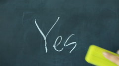 Chalk writing - Yes and erasing it and writing No on chalkboard Stock Footage