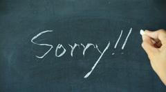 Chalk writing - Sorry on chalkboard Stock Footage
