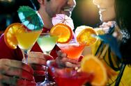 Close-up of martini glasses with people in the background Stock Photos