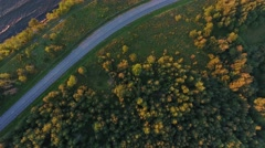 Aerial view to cliff, sea and car driving on road Stock Footage