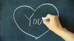 Chalk drawing - You in heart shape on chalkboard Stock Footage