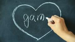 Chalk drawing - Game in heart shape on chalkboard Stock Footage
