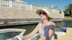 Young woman enjoying a holiday resort in Europe. Floating on a boat on the Stock Footage
