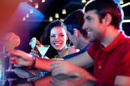 Row of young people communicating at bar Stock Photos
