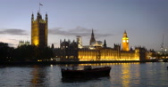 Pan over the River Thames with Big Ben and the Palace of Westminster at dusk Stock Footage