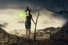 Pretty asian witch woman with magic broom emit light Stock Photos