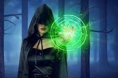 Asian witch woman with cloak showing green pentagram Stock Photos