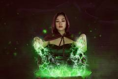 Asian girl witch with red cloak preparing a magic potion Stock Photos
