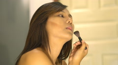 Young Asian Woman applying powder with big brush 4k UHD (3840x2160) Stock Footage